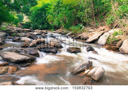 Mae Ya waterfall with green trees and small creekbackgroundat Doi Inthanon National Park Chiangmai Thailand