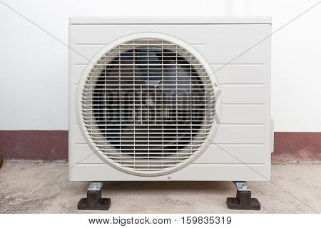 Air compressor for air conditioner system outside building.