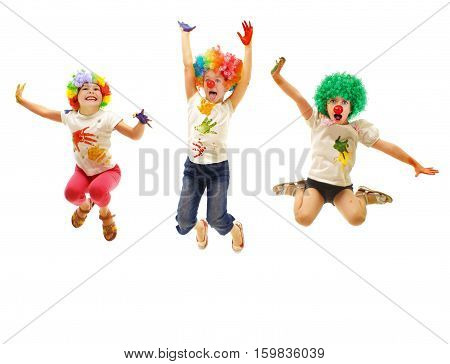 Jumping children wearing clowns costumes isolated on white