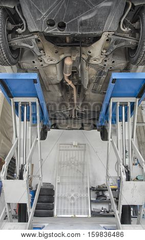 View of car bottom in a garage