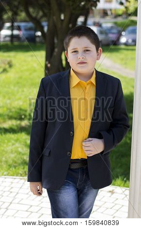 the boy's portrait in a yellow shirt at colons a subject beautiful children school students