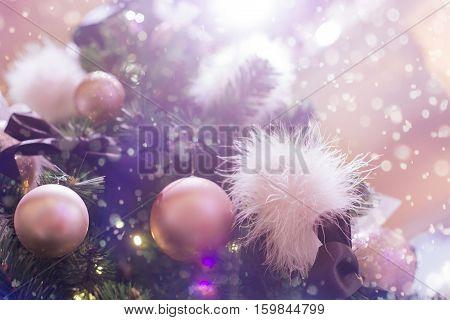Glamorous Christmas tree. Pink Christmas balls and balls of feathers.