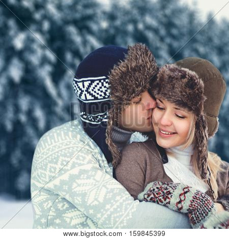 Portrait Happy Young Couple In Love At Winter Day, Man Gentle Kissing Woman Wearing Hat And Knitted
