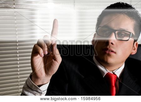 Business man at office touching digital screens