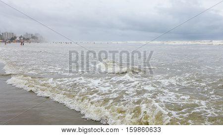 Turbulent seashore with ripples arriving at seashore