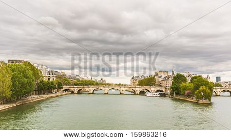 View of Seine and Ile de la Cite in Paris. Pont Neuf New Bridge in english is the main subject. Paris typical architecture.