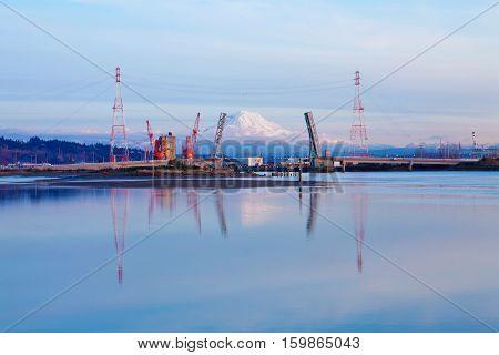 Mt.ranier And Tacoma Port With Cranes And Bridge.