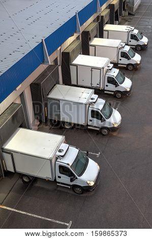 Saint-Petersburg Russia - October 31 2016: Top viev row of trucks at a loading dock.