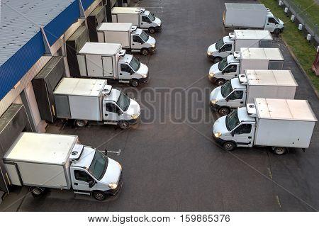 Saint-Petersburg Russia - October 31 2016: Top viev trucks loading unloading at warehouse.