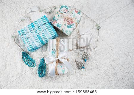 Various Christmas presents in home blue, white