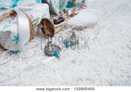 Various Christmas presents in home white blue