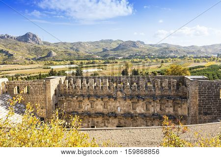 Rural scene in Aspendos, Turkey with ruins of the Roman theater.