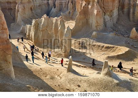 QESHM ISLAND, IRAN - Febrary 28, 2016: People walking through Stars Valley. Mountain range at Qeshm Island, Iran