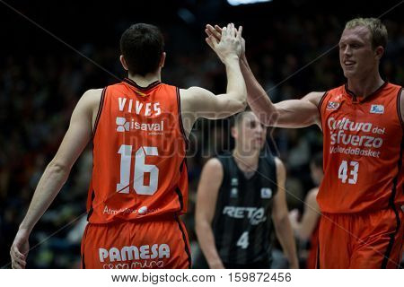 VALENCIA, SPAIN - DECEMBER 3: 16 Vives, 43 Sikma during spanish league match between Valencia Basket and Bilbao Basket at Fonteta Stadium on December 3, 2016 in Valencia, Spain