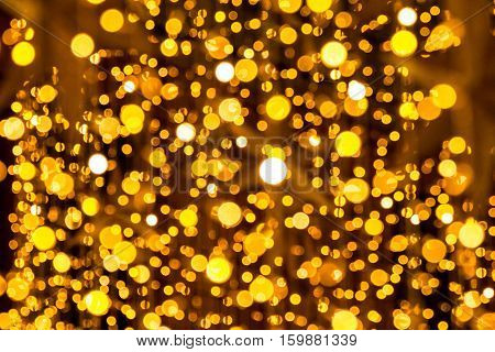 Bokeh-abstraction: A fairy of soaring gold and lights circles.