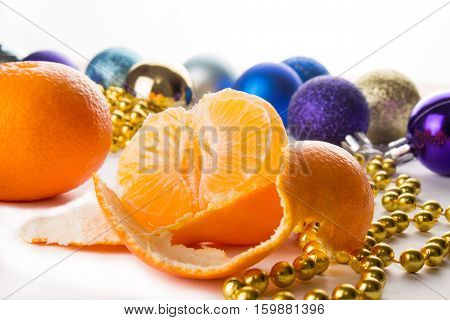 purified tangerines with Christmas decorations on the white