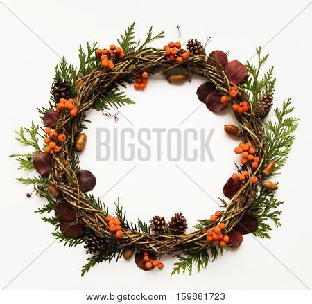 Festive Wreath Of Vines With Dry Leaves, Thuja Branches, Rowanberries And Cones. Flat Lay, Top View