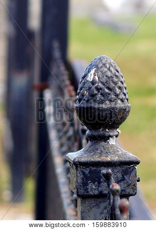 Black iron acorn newell post adornment on antique fence