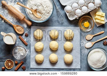 Buns dough mixing recipe bread, pizza or pie making ingridients, food flat lay on kitchen table background. Working with butter, milk, yeast, flour, eggs, sugar pastry or bakery cooking.