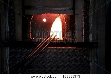stove in darkness at glass making factory