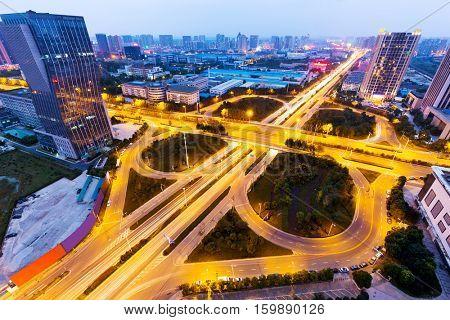 illuminated road junction in midtown of hefei,anhui at twilight