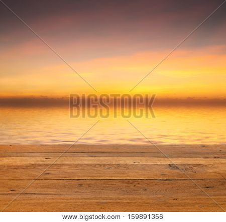 Sunset Over Calm Off Wooden Deck