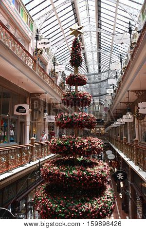 Sydney Australia - Dec 3 2016. Tall Indoor Christmas Tree With Decoration in The Strand shopping arcade.