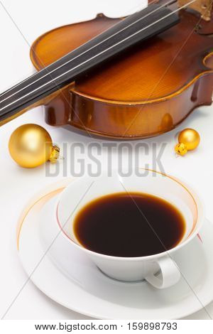 Cup of coffee old violin and Christmas decoration on the white background