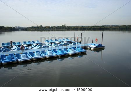 Peddle Boats Moored On Lake