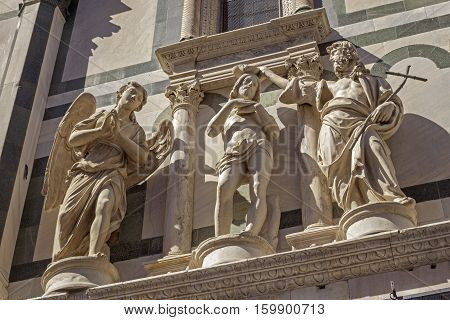 Sculptures of Baptism of Christ - on baptistery of St. John in Florence Italy