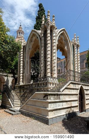 CATANIA ITALY - AUGUST 17 2016: Gothic pavilion in the cloister of the Benedictine Monastery of San Nicolo l'Arena in Catania Sicily Italy