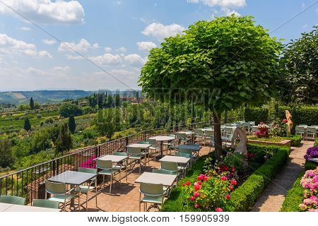 Outdoor Restaurant Over Tuscan Landscape