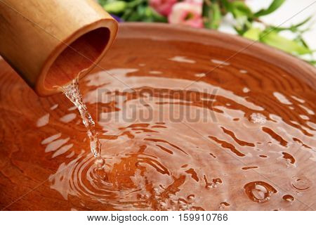 Beautiful spa composition with pouring water