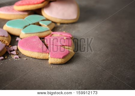 Tasty colourful heart shaped cookies on grey background