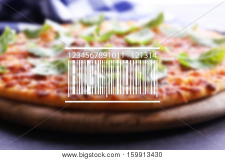 Barcode on blurred pizza background. Wholesale and retail concept.