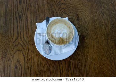 in a cup on the table is a hot coffee with sugar