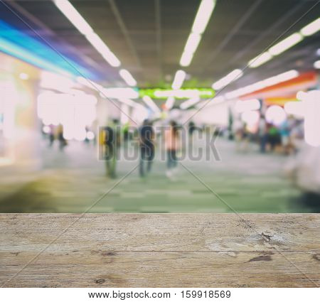 Wooden Counter Top With Blurred Walk Way To Boarding Gate At Airport