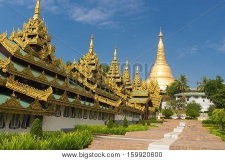 Southern staircase leading to Shwedagon Paya, the most sacred golden buddhist pagoda in Myanmar. Yangon, Myanmar