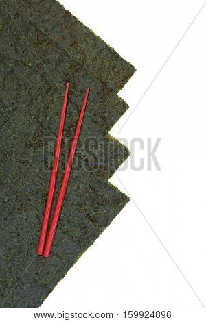 Japanese nori seaweed with red chopsticks on white background with copy space.