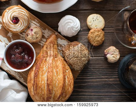 Breakfast table with pastries and drinks, top view