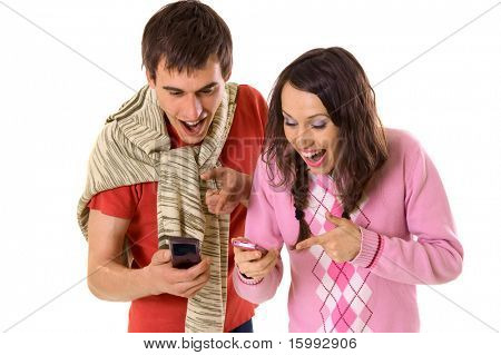 happy man and woman pointing at mobile