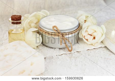 Botanical facial mask with blossom. Fresh cosmetic product in jar, beige garden rose. Pampering plant-based skincare.