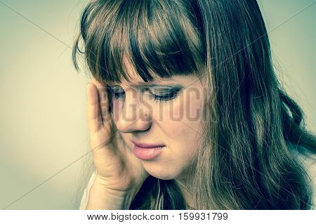 Close up portrait of a crying woman with bruised skin and black eyes - retro style