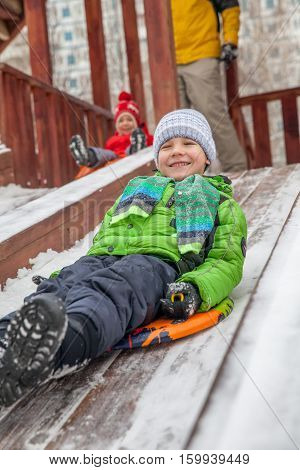 Winter portrait of kid boy in colorful clothes, outdoors