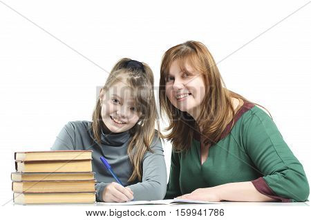 Child With Her Mother Doing School Lessons.