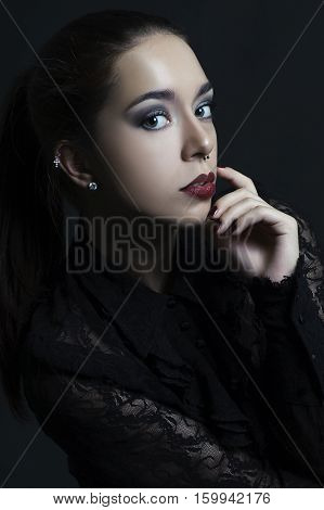 Portrait Of A Beautiful Young Woman On A Black Background..