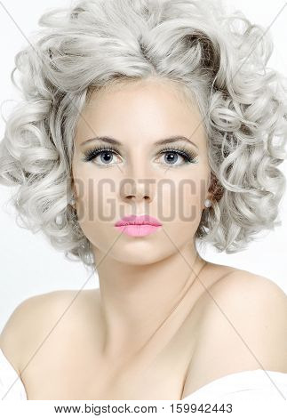 Beauty Portrait Of A Woman With Silver Hair And Bare Shoulders..
