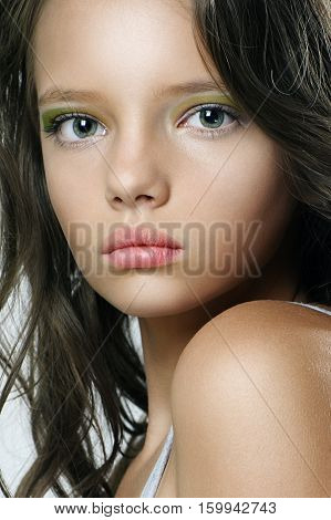 Beauty Portrait Of A Beautiful Young Girl With Expressive Eyes..