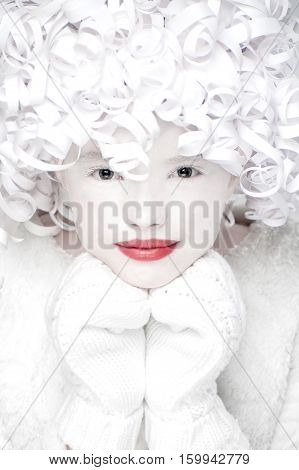 Portrait Of Charming In Mittens With White Snow-covered Face..