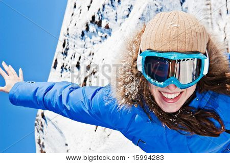 happy young woman in ski sunglasses
